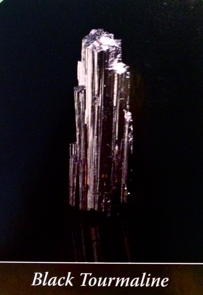 Black Tourmaline, from the Crystal Wisdom Oracle Card deck, by Judy Hall